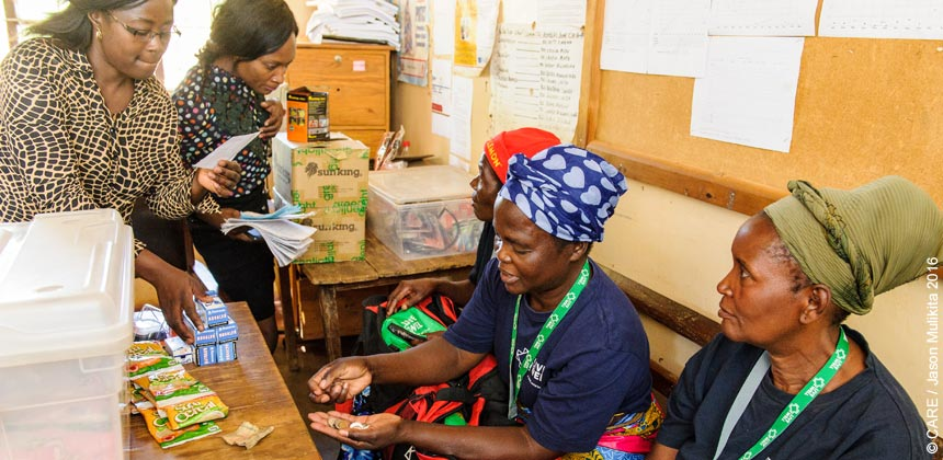 zambia_live-well_three-women-buying-health-products_860px